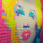 A wall filled with Post-it notes at Valltech.
